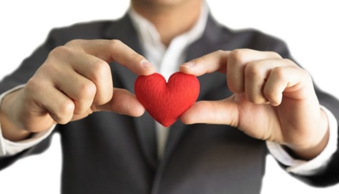 business man holding heart
