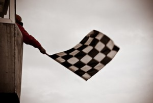 Man waving checkered Flag
