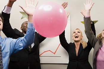 Outbound Telemarketing Employees celebrating with a pink ball