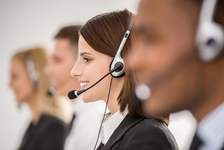 Telemarketing services agent talking on a headset
