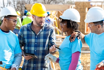 Construction workers building a solid foundation in B2B Telemarketing